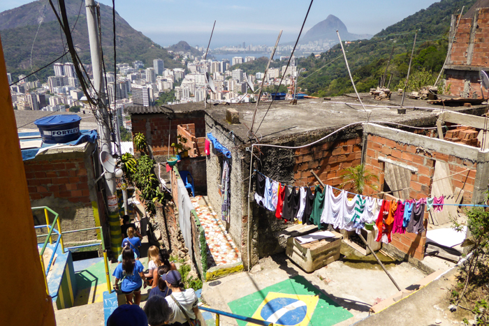 Students make their way through the favela, learning the community's history and challenges from their local guides along the way.